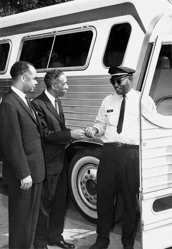 FAMU president George Gore presenting keys for new bus to driver Tommy L. Gaines in Tallahassee.