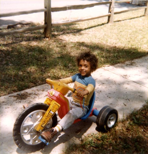 Sam Jones riding a Big Wheel in Tallahassee.