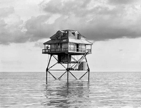 Deactivated light station on stilts located near the entrance to the Northwest Channel leading into Key West, Florida.