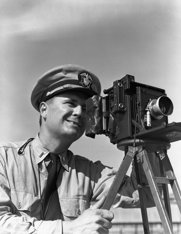 Lt. Joe J. Steinmetz with Speed Graphic camera at NAS Pensacola.