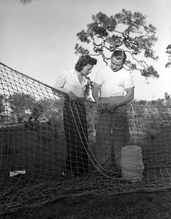 "Trapeze artists Arthur ""Art"" and Antoinette ""Toni"" Concello mending their safety net in Sarasota, Florida."