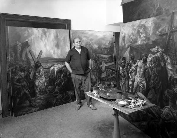 "Artist Ben Stahl in the studio with his paintings for his ""Museum of the Cross"" in Sarasota, Florida."