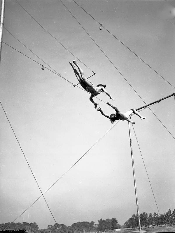 """Viewing showing trapeze artist Antoinette """"Toni"""" Concello and partner practicing at the Ringling Circus winter quarters in Sarasota, Florida."""