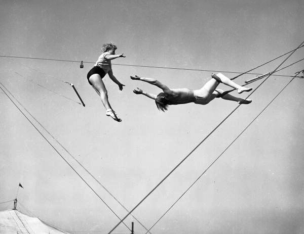 Viewing showing trapeze artists practicing at the Ringling Circus winter quarters in Sarasota, Florida.