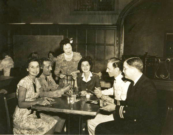 Naval Photography School instructor Lt. Joe Steinmetz, right, with group playing Bingo at NAS Pensacola.