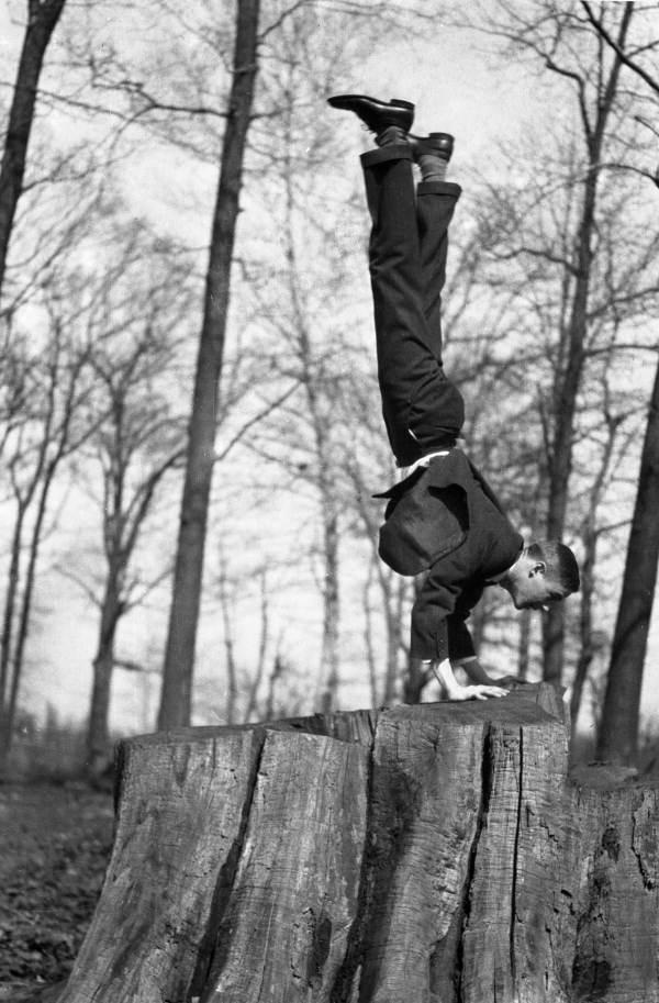 Joe Steinmetz, as a young man, doing a handstand on a tree stump at Wissahickon Park in Philadelphia, Pennsylvania.