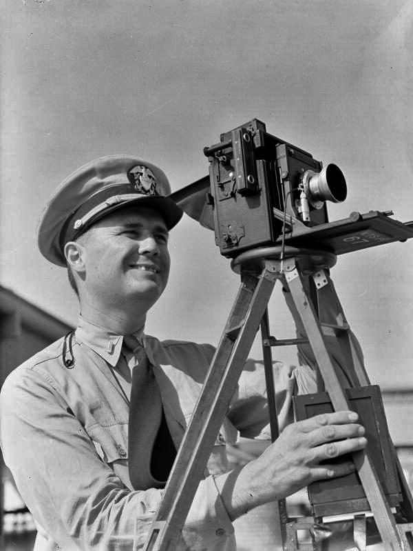USNR Lt. Joe J. Steinmetz with Speed Graphic camera at NAS Pensacola.