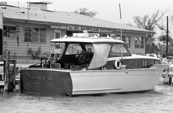 "View showing the ""Mark II"" boat from Tampa in front of Bea & Bill's Happyland seafood restaurant at 9009 Midnight Pass Rd. on Siesta Key, Florida."