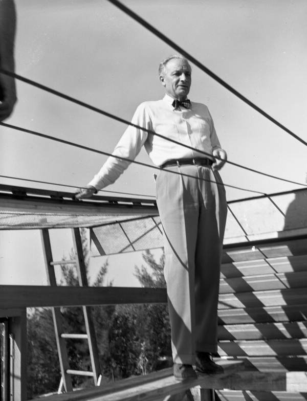 Portrait of architect Ralph Twitchell on site during construction of his cantilever roof house on Siesta Key near Sarasota, Florida.