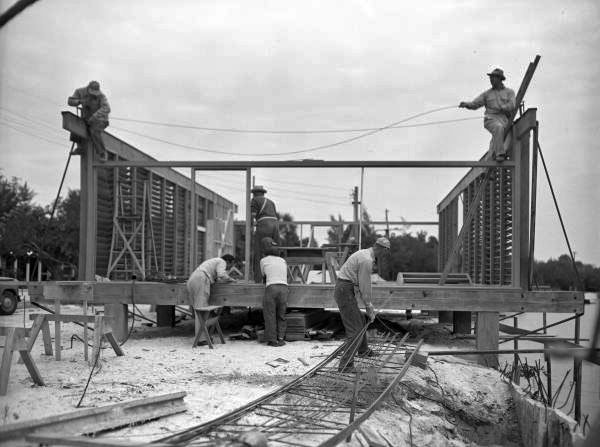View showing workers constructing architect Ralph Twitchell's cantilever roof house on Siesta Key near Sarasota, Florida.