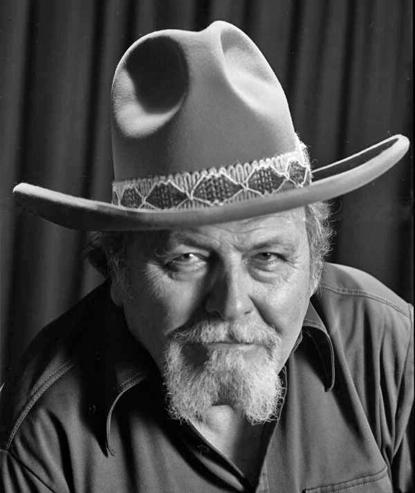 Close-up portrait of painter Ben Stahl wearing a cowboy hat in Sarasota, Florida.