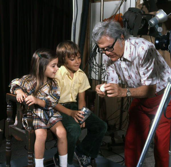 "Photographer Joe Steinmetz ""breaking the ice"" with children by doing magic tricks prior to the portrait photo session at his studio in Sarasota, Florida."