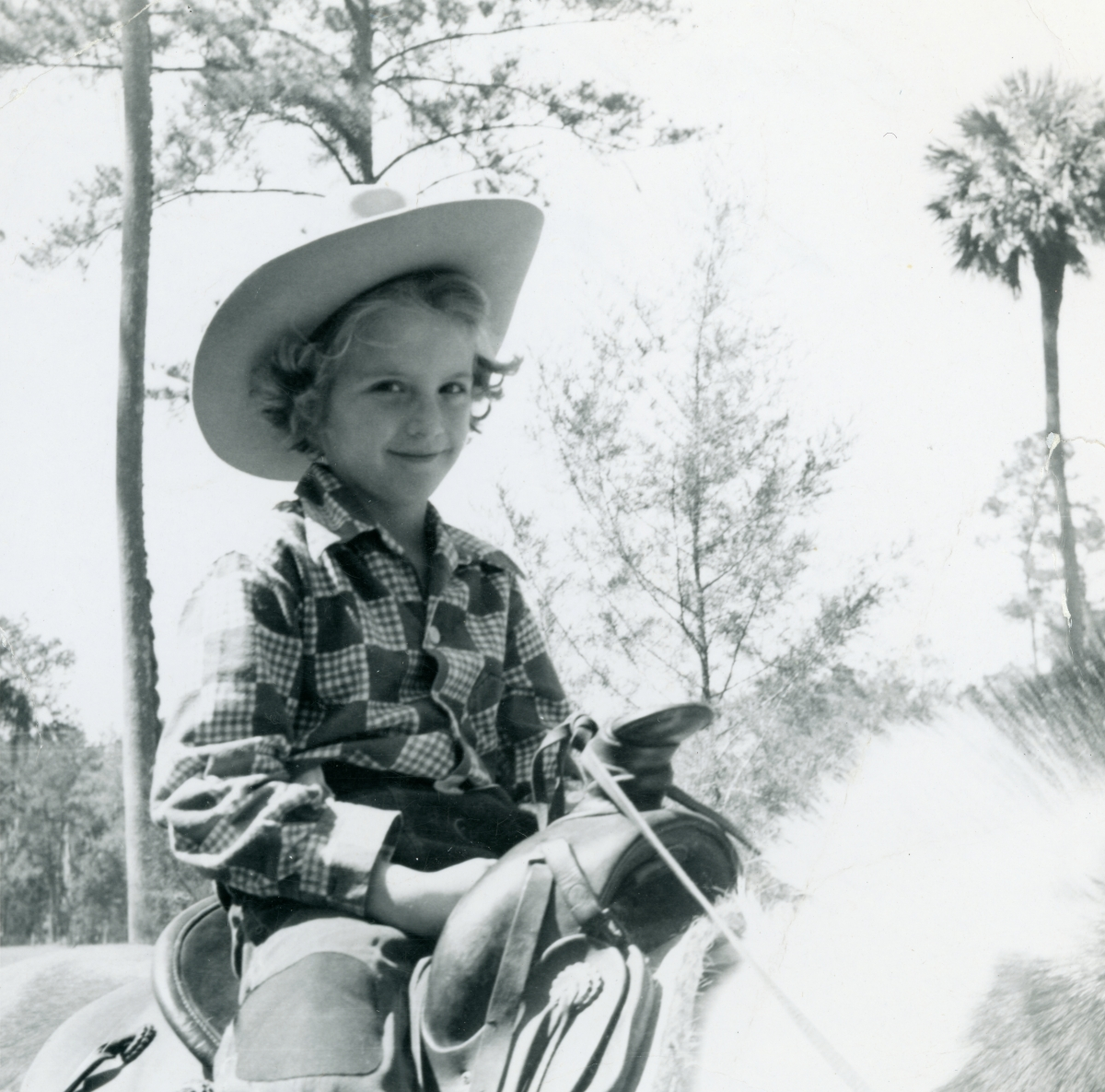 Outdoor portrait of 6 1/2-year-old little cowgirl Diane Raney.