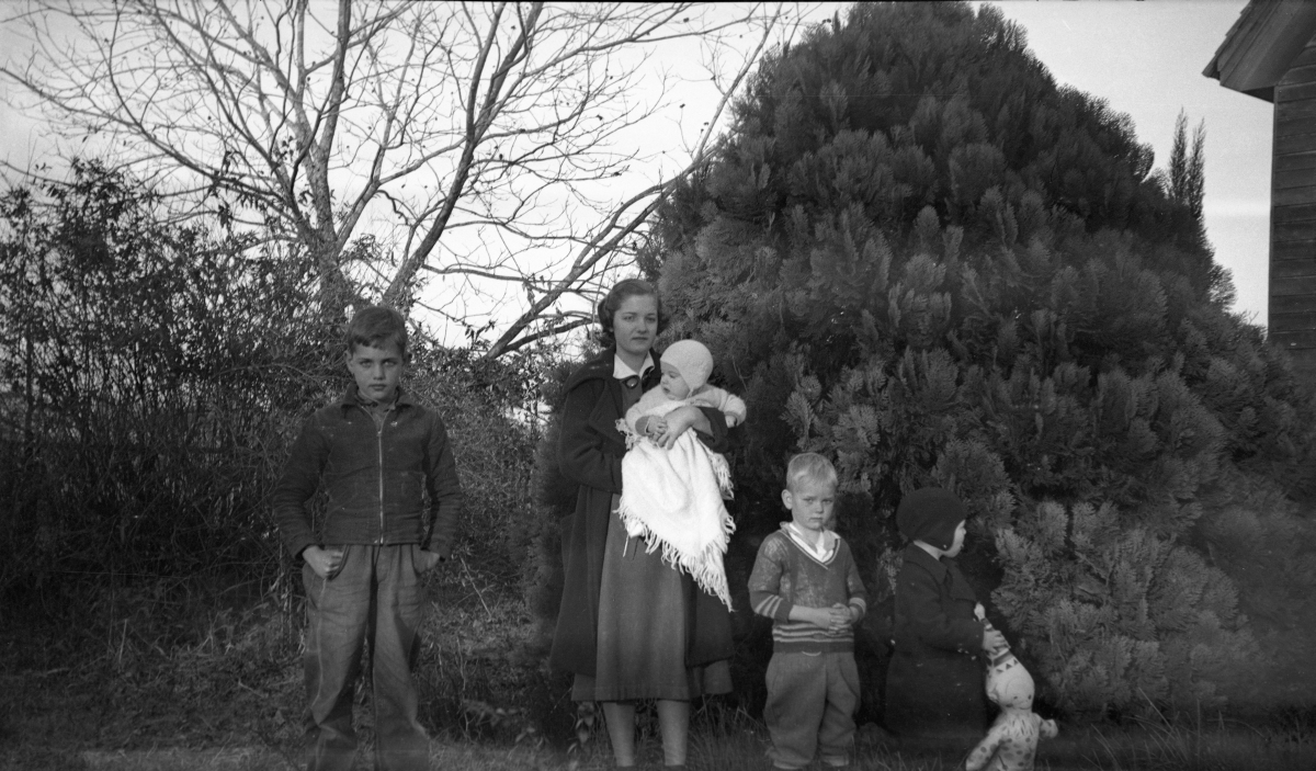Peavy family portrait behind their house in Concord.