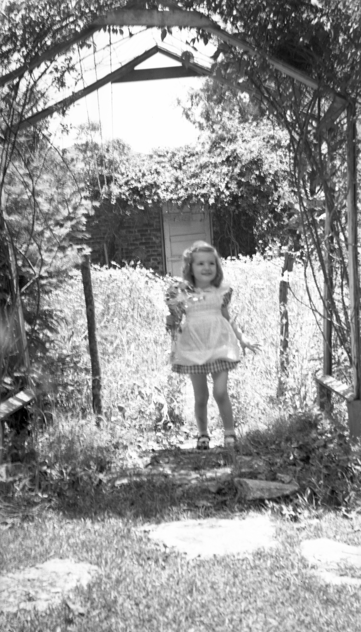 Sandra Dixon with flowers in the garden at her grandmother's house in Tallahassee.