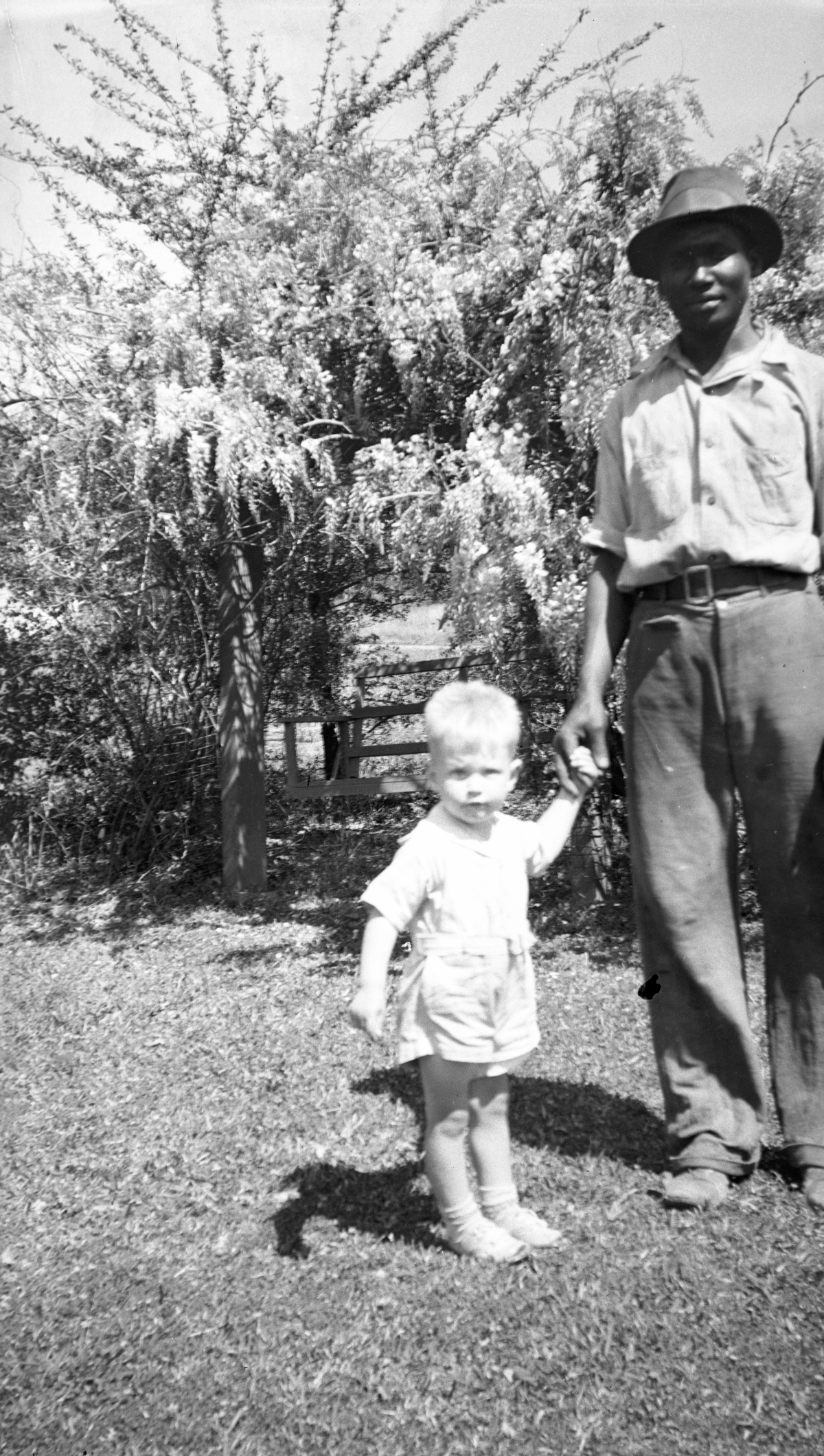 Warren Dixon in the backyard with gardener Willie Caswell at his grandmother's house in Tallahassee.