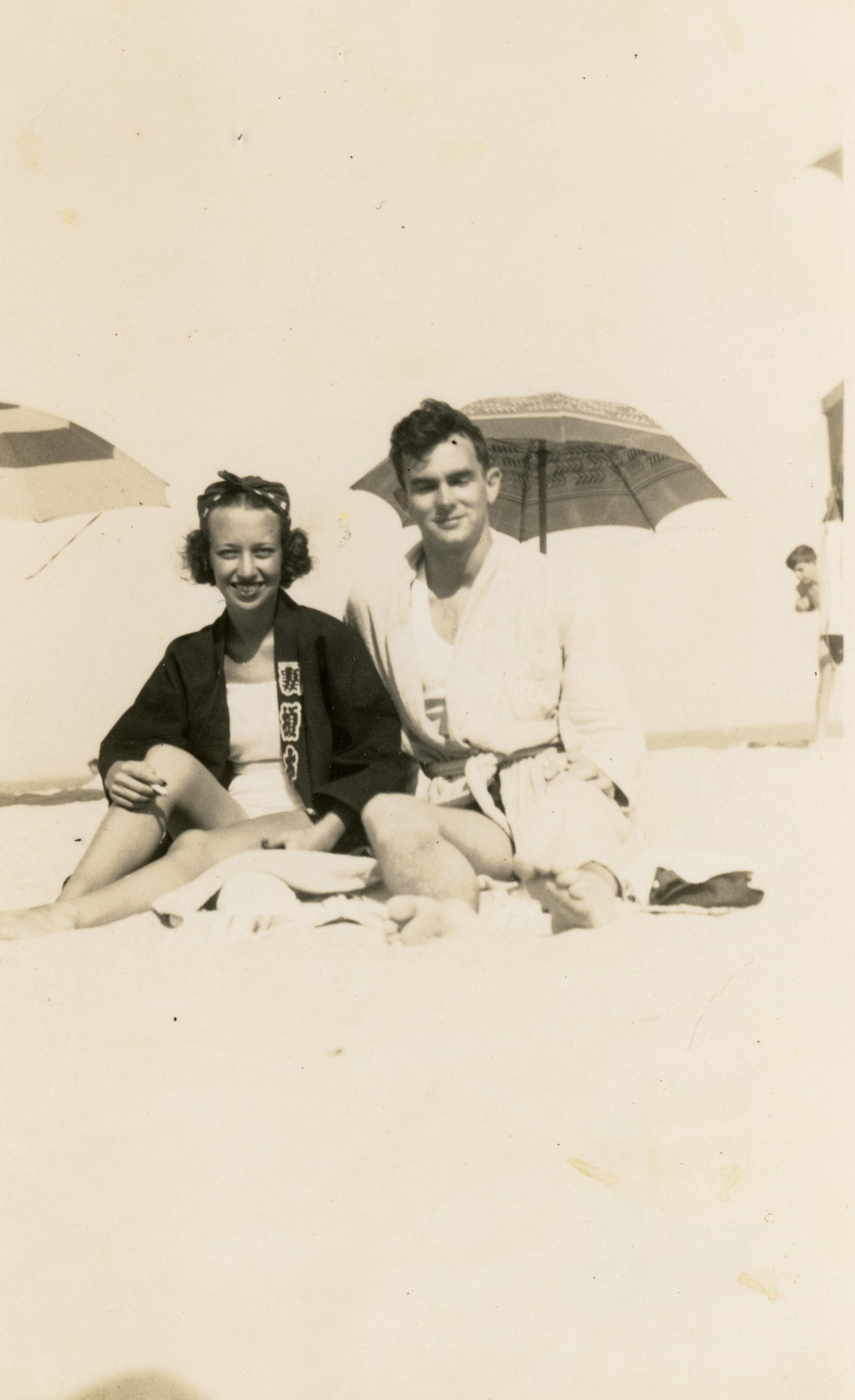 Portrait of Major General Albert H. Blanding's son William at the beach with fiancee Betty.