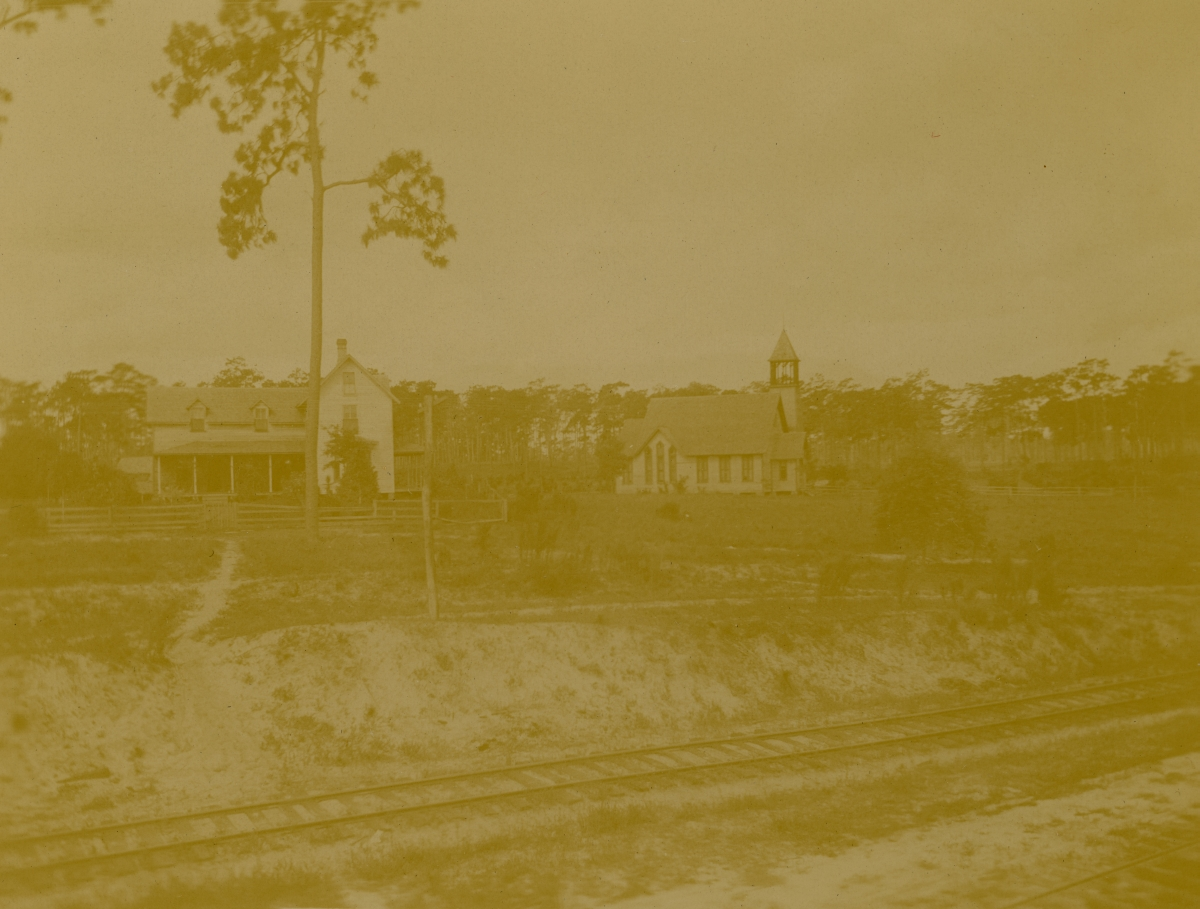 J. Morrison's place at left with Congregational Church on the right in Pomona.