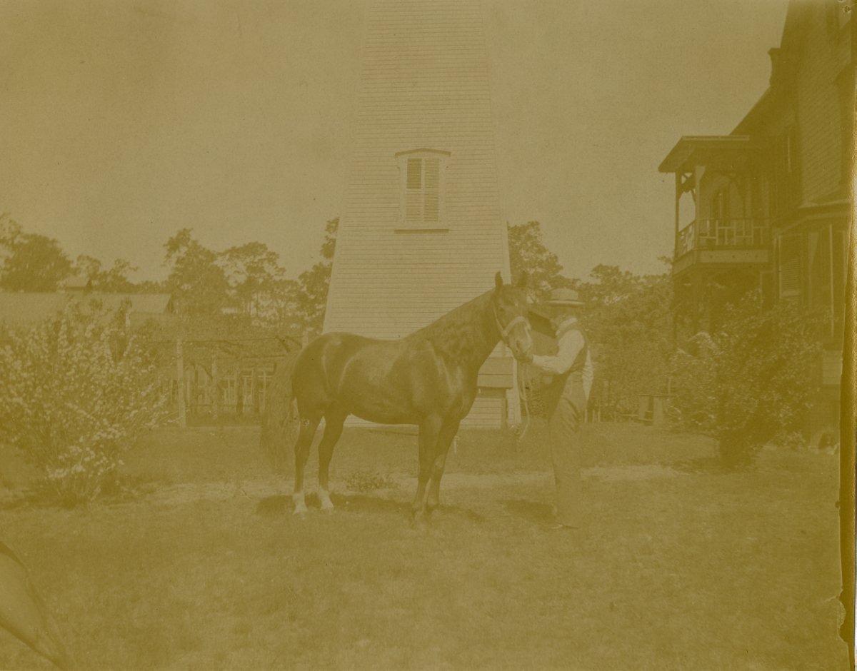Mr. Charles Worcester with his horse in Pomona.