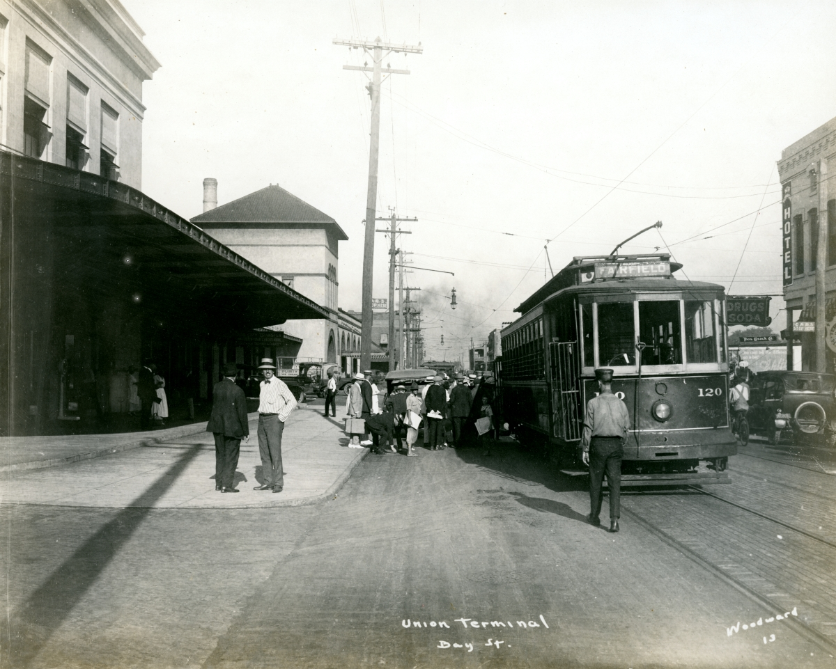 Passengers leaving the Union Station railroad depot and boarding a trolley car on Bay St. in Jacksonville.