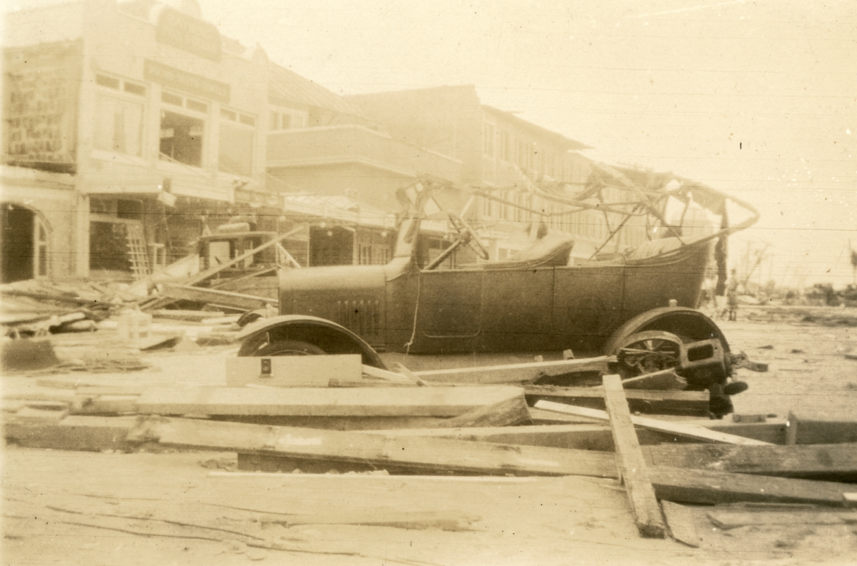 Close-up view showing damaged car on Biscayne St. following the 1926 hurricane.