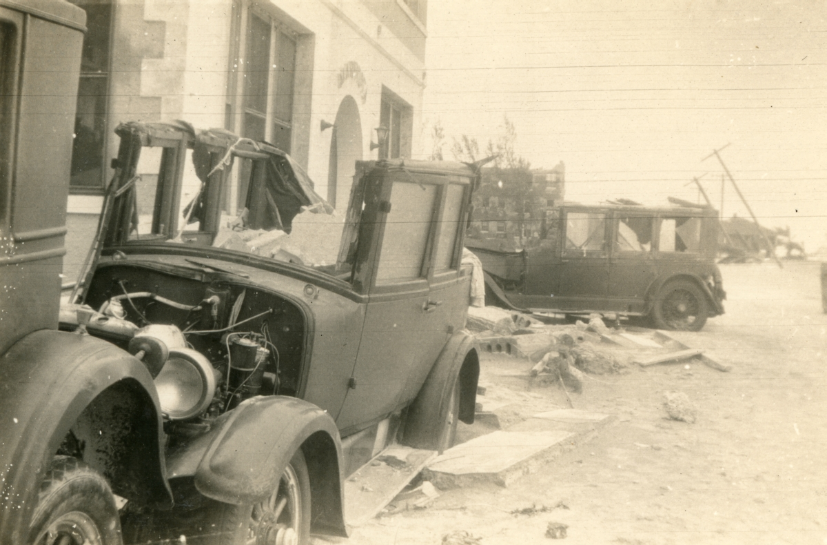 Close-up view showing cars damaged by the 1926 hurricane in Miami Beach.
