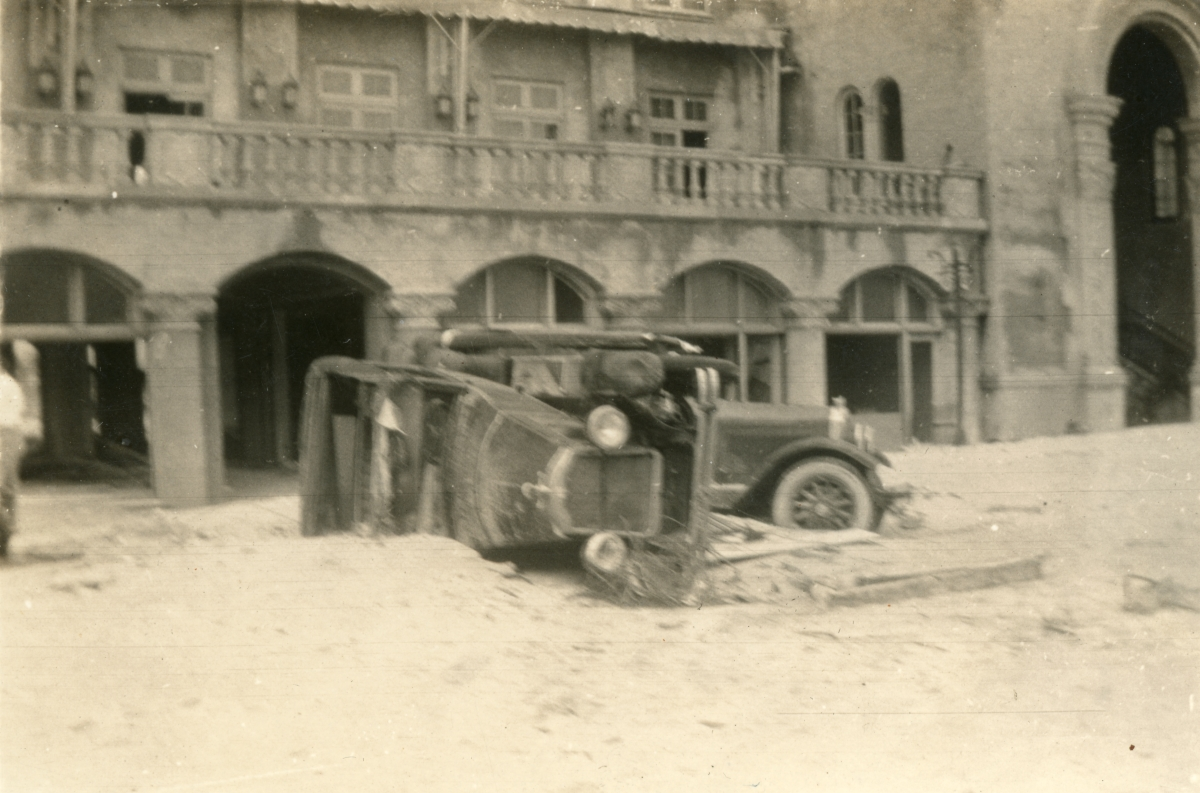 Cars in front of the Roney Plaza Hotel damaged by the 1926 hurricane in Miami Beach.