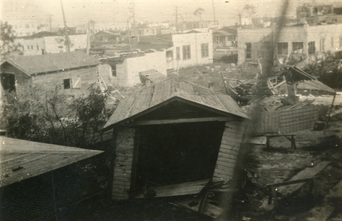 Damaged home and outbuildings shown following the 1926 hurricane in Miami Beach.