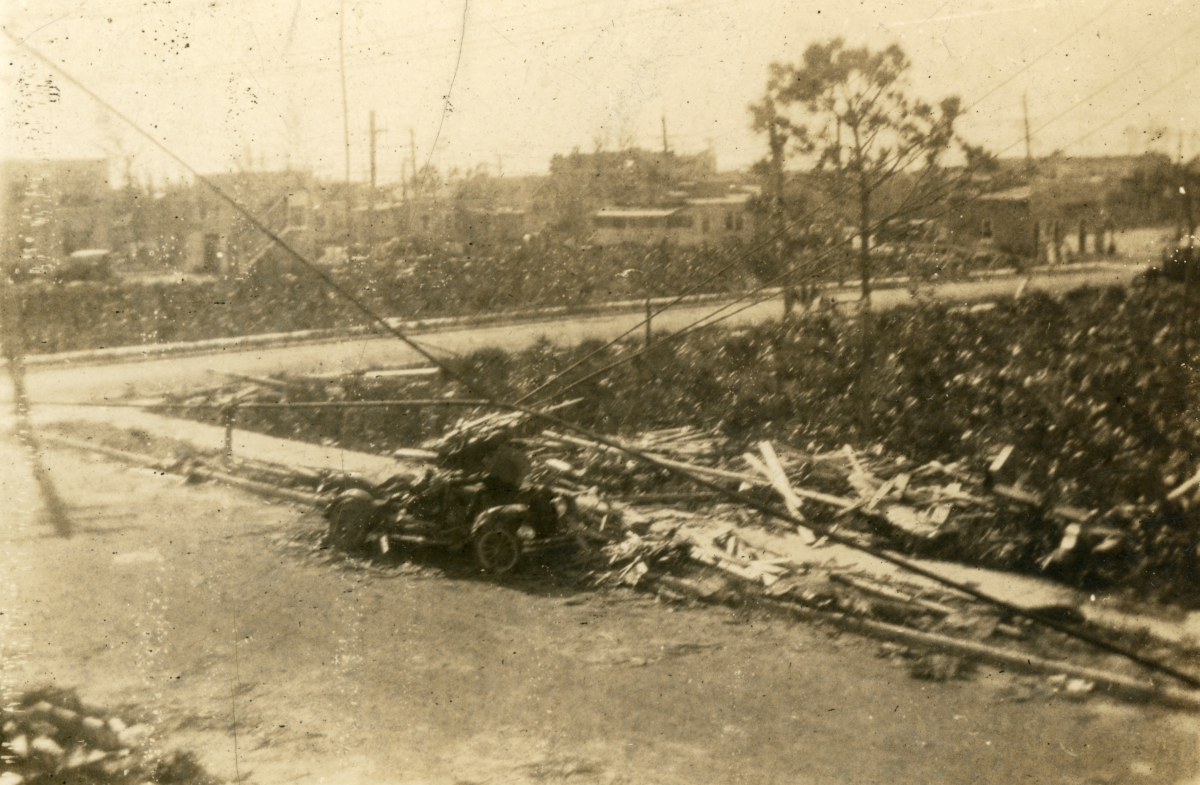 New car demolished by apartment roof during the 1926 hurricane in Miami Beach.