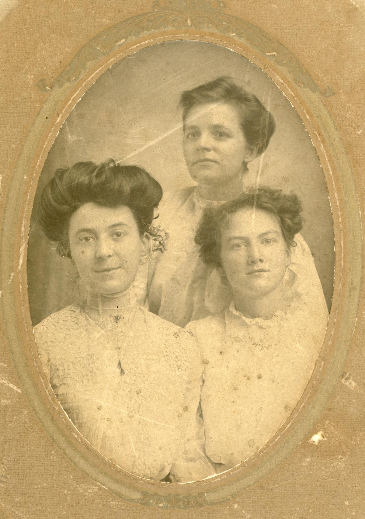 Studio portrait of three women.