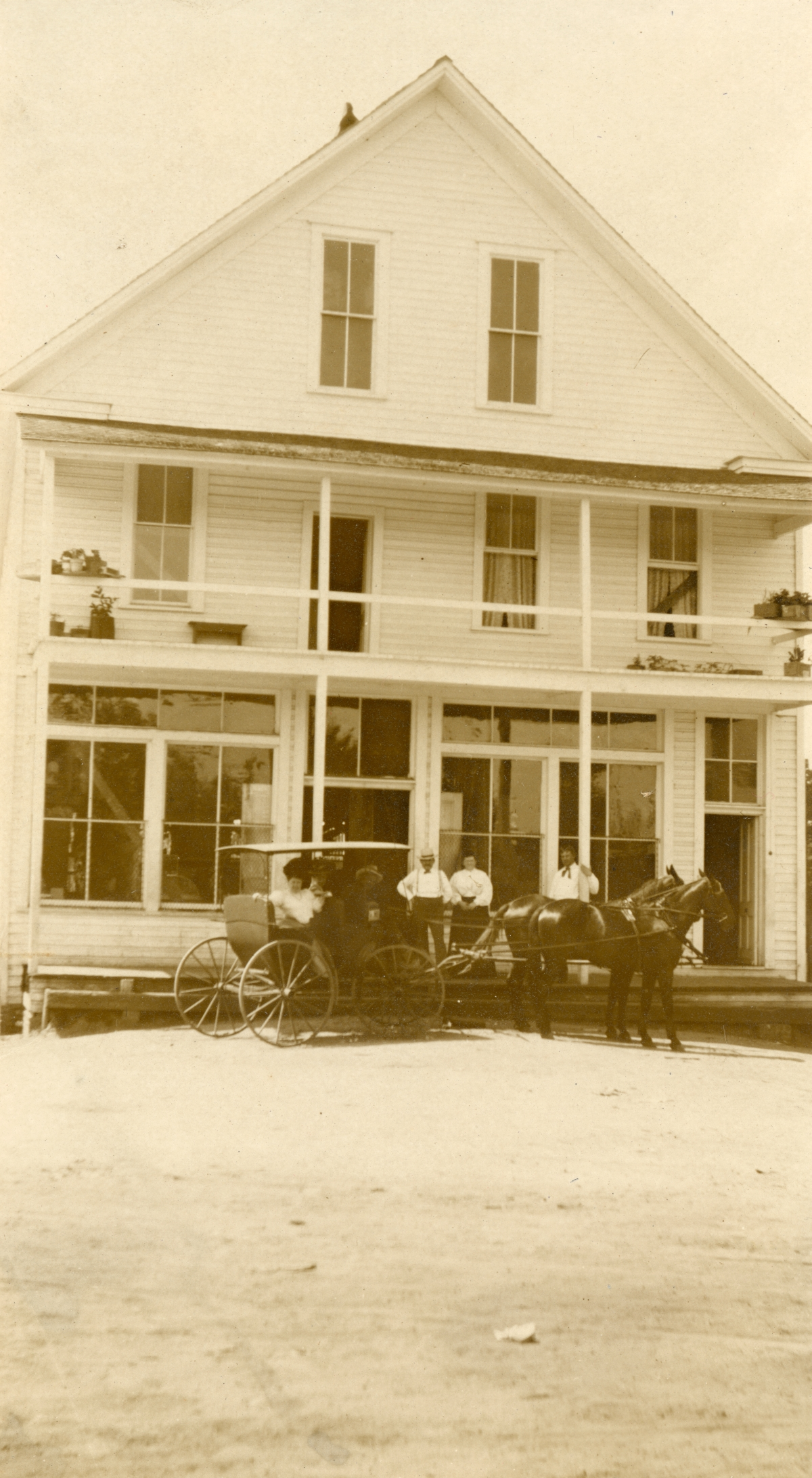 People with carriage in front of a Gadsden County general store.