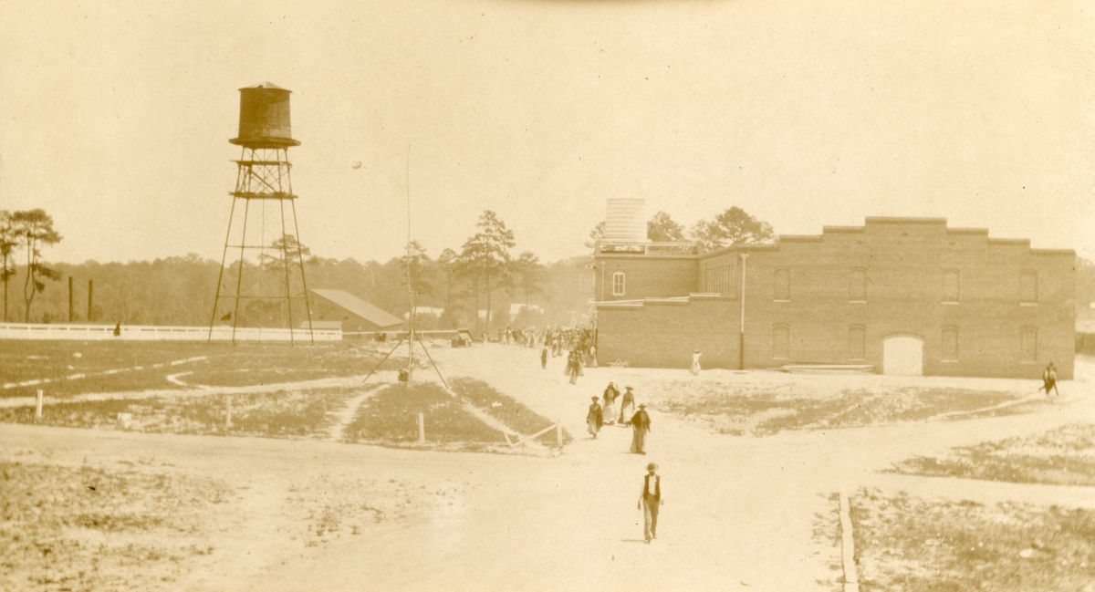 Workers leaving a Gadsden County tobacco packing house.
