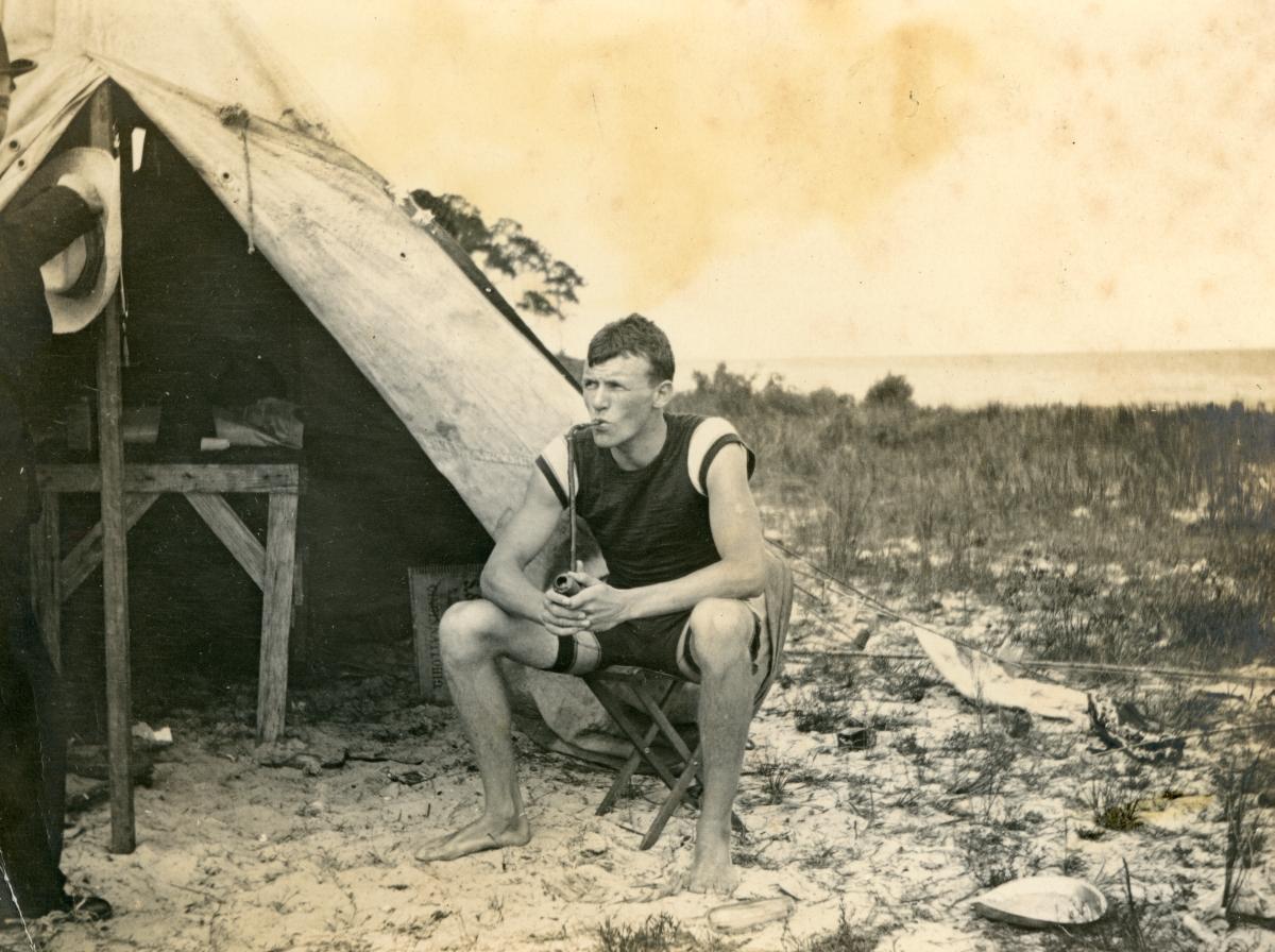 Charles G. Puleston smoking a pipe in Lanark.