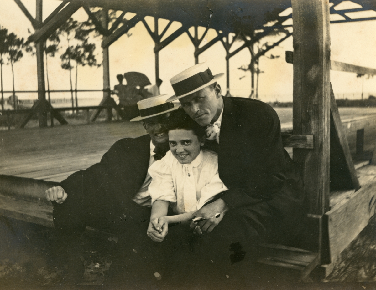 Ethel Miller sitting at a shelter with two friends in Lanark.