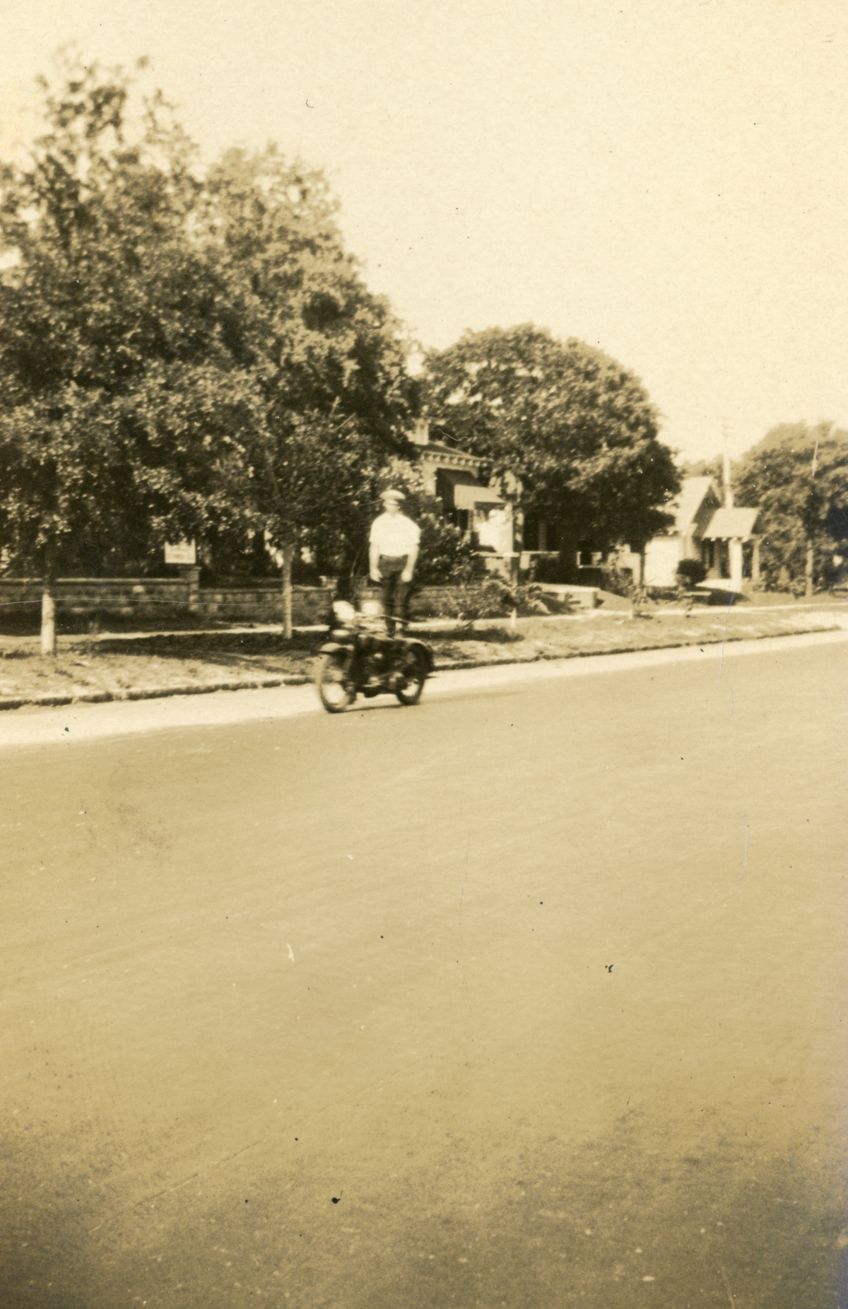Luther W. Coleman trick riding his motorcycle on 4th St. in St. Petersburg.