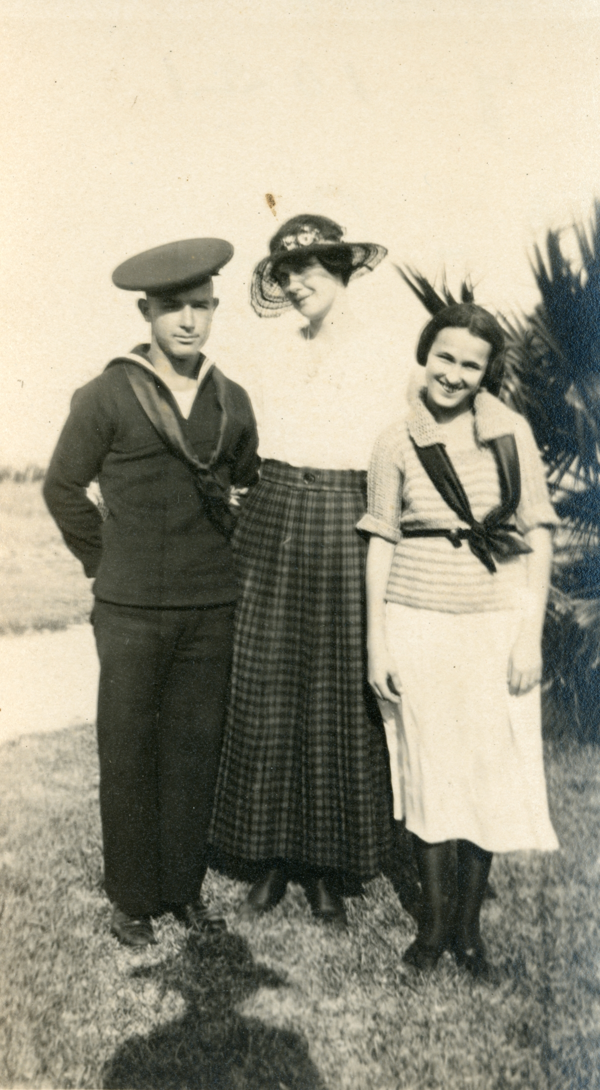 Unidentified woman, center, with Luther and his sister Mary Coleman in St. Petersburg.