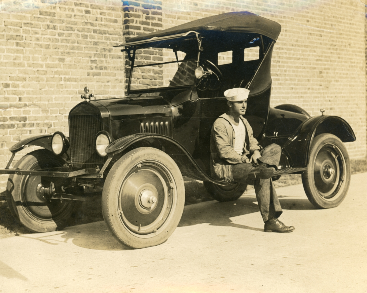 Luther W. Coleman sitting on his Chevrolet in St. Petersburg.