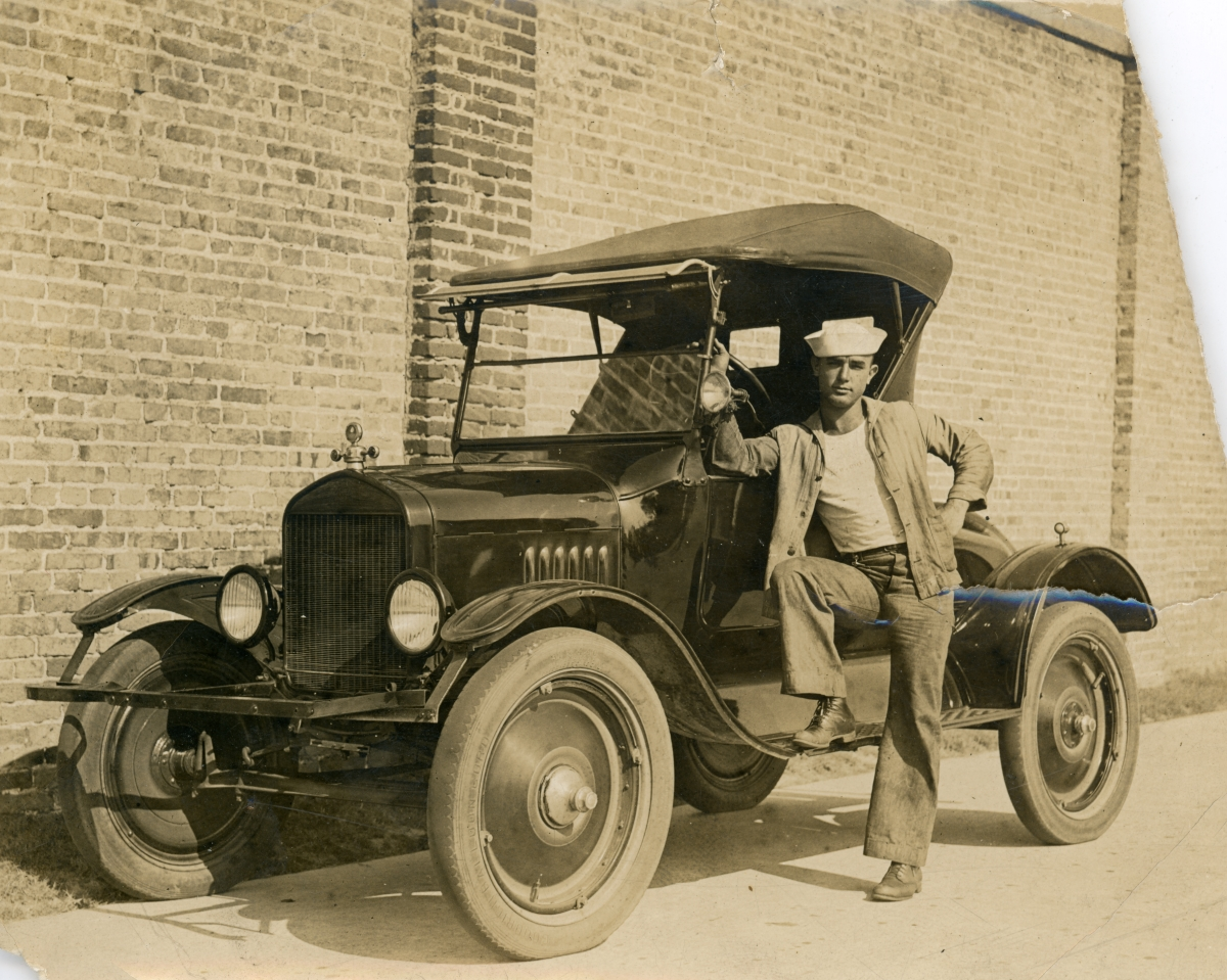 Luther W. Coleman standing with his Chevrolet in St. Petersburg.