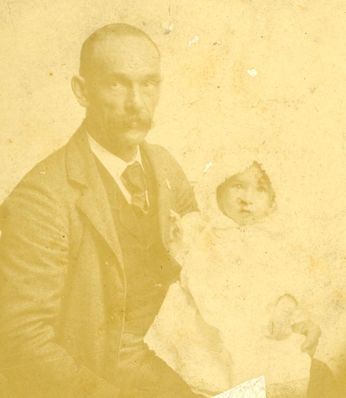 Portrait of Walter William Coleman with his granddaughter Hazel.