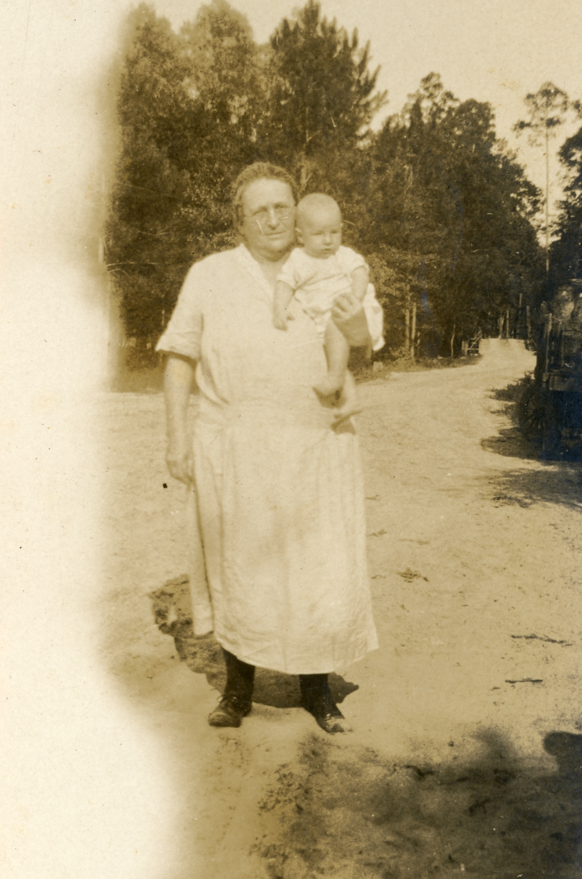 Luther W. Coleman being held by his grandmother Leila in Milton.
