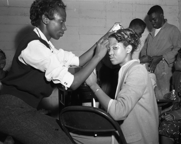 "FAMU student Annie McKinney applying make-up to high school student Dorothy Bain for the play ""The Plum Tree"" at Lee Hall in Tallahassee, Florida."