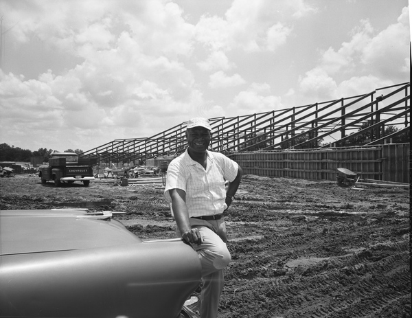 Coach Jake Gaither in front of the new FAMU football stadium under construction in Tallahassee.