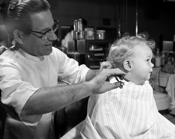 Nine month old Dorian Stripling getting his first haircut in Tallahassee, Florida.