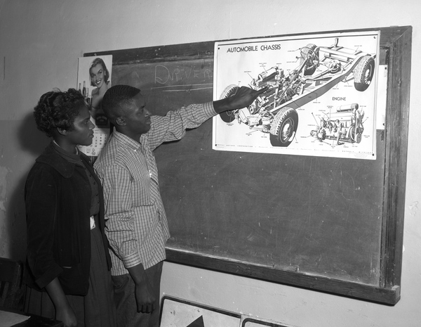 Lincoln High School students examining diagram during driver training class in Tallahassee, Florida.