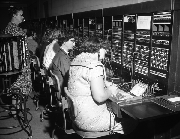 Telephone operators and switchboard in Tallahassee, Florida.