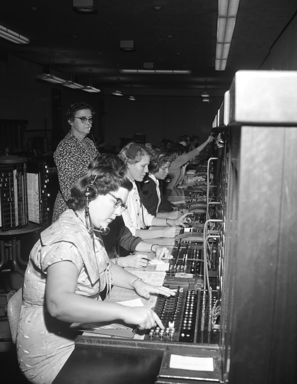 Telephone operators at switchboard in Tallahassee, Florida.