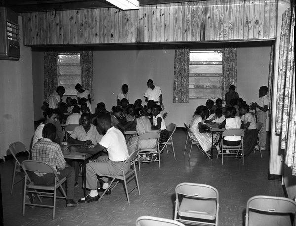 African American boys and girls playing board games at the new Dade Street Recreation Center in Tallahassee.