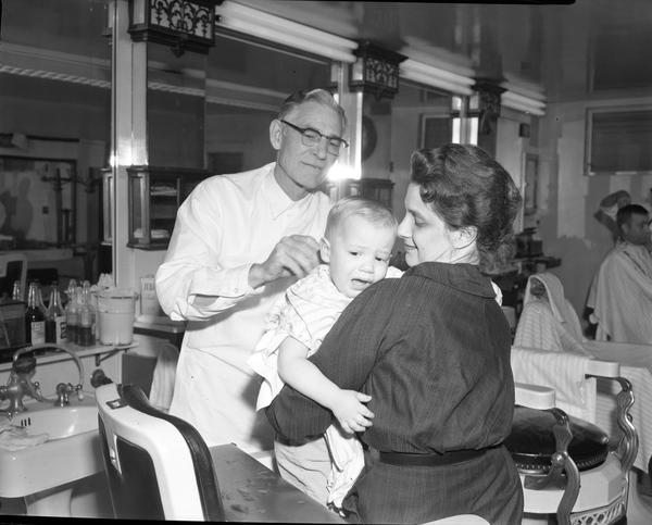 John Wilkinson getting his first haircut from Tom Fair in Tallahassee.