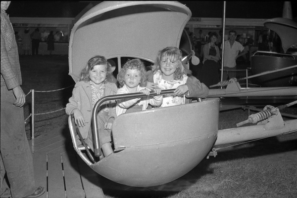 Children on an amusement ride at the North Florida Fair in Tallahassee.