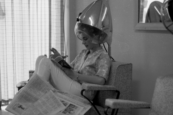 Woman under hair dryer at a beauty shop in Tallahassee.